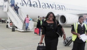Mwandira-one-of-the-first-passengers-to-fly-on-Malawian-Airlines-plane-from-South-Africa-after-landing-at-Chileka-Airport-in-Blantyre-Pic-Lucky-Mkandawire-600x450-600x350